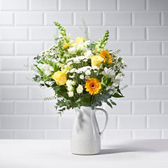 Wide shot of Rise & Shine in a vase - luxury bouquet of flowers - yellow roses and yellow gerberas