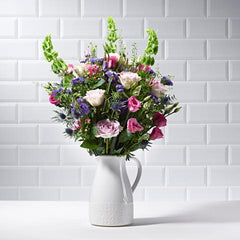 Wide shot of Secret Garden in a vase - luxury bouquet of flowers - lilac roses and pink lisianthus