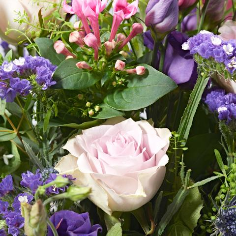 Close up of Secret Garden - luxury bouquet of flowers - lilac roses and pink lisianthus