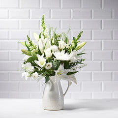 Wide shot of Snowflakes in a vase - luxury bouquet of flowers - white lilies, white roses