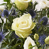 Close ups of White Christmas - letterbox bouquet of flowers - white roses, white lilies, white lisianthus
