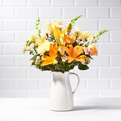 Wide shot view of Sunrise - luxury bouquet of flowers - orange lilies and yellow chrysanthemums