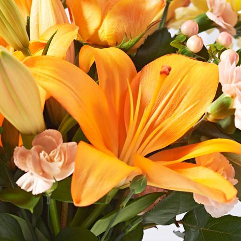 Close up of Sunrise - luxury bouquet of flowers - orange lilies and yellow chrysanthemums