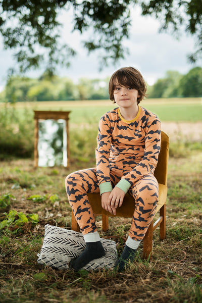 Waves Pheasant Kids Slim Jyms pyjamas by The Bright Company. Modern, stylish super soft organic cotton sleep wear for children and grown ups. Free UK shipping on orders over £49. 10% discount when you subscribe for our newsletter.
