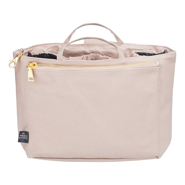 Compact Sand Insert by The Nappy Society. Inserts allow modern mamas to turn any tote bag into a changing/diaper bag. Fits inside medium and large totes/handbags. Available in two colours and two sizes. Free UK shipping on all orders over £49. 10% discount when you subscribe to our newsletter.