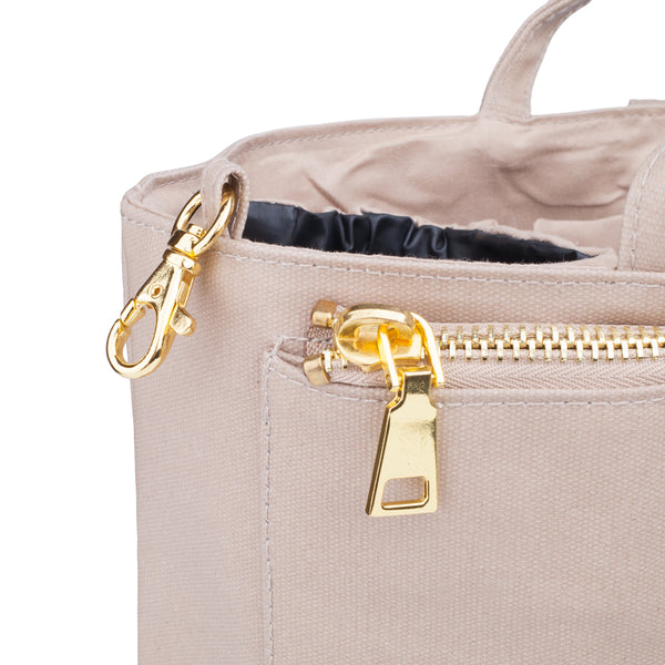 Original Sand Insert by The Nappy Society. Inserts allow modern mamas to turn any tote bag into a changing/diaper bag. Fits inside medium and large totes/handbags. Available in two colours and two sizes. Free UK shipping on all orders over £49. 10% discount when you subscribe to our newsletter.