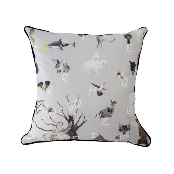 A-Z animal print cushion by independent British brand Wild Hearts Wonder features kangaroos, unicorns, bats and fawns and animal print on the reverse