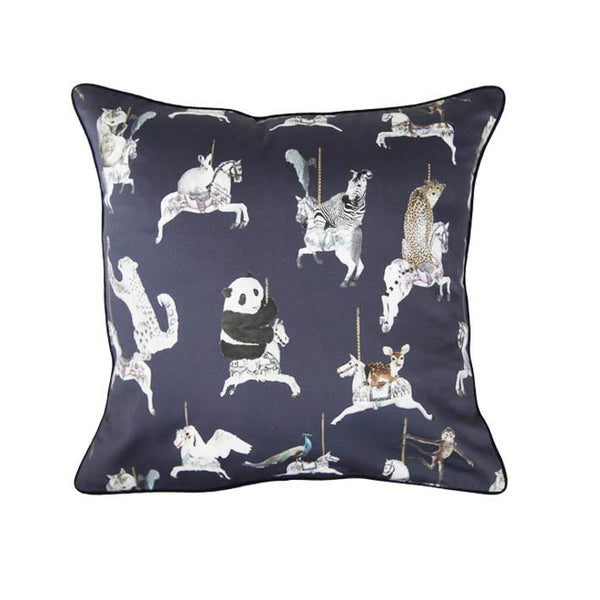 Carousel animal print cushion by independent British brand Wild Hearts Wonder featuring carousel horses on the front and raindrop print on the reverse