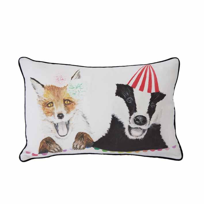 Fox and Badger print cushion by independent British brand Wild Hearts Wonder featuring hand drawn fox and badger print on the front and animal spot print on the reverse