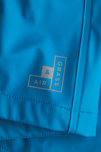 Girls Turquoise Rainster waterproof jacket by British brand Grass & Air - modern, stylish rainwear for kids