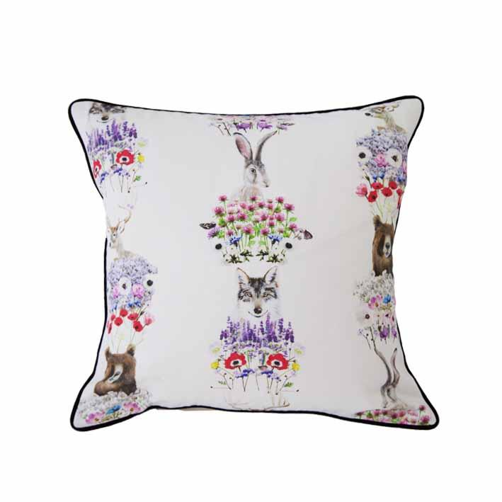 Nordic animals and wildflowers print cushion by independent British brand Wild Hearts Wonder featuring nordic animals and wildflowers on the front and wildflowers on the reverse