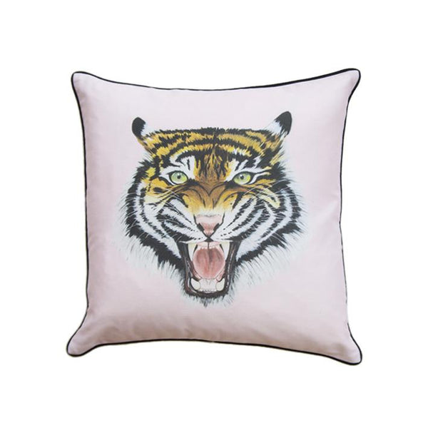 Wild tiger print cushion in pink by independent British brand Wild Hearts Wonder featuring tiger print on the front and animal spot print on the reverse