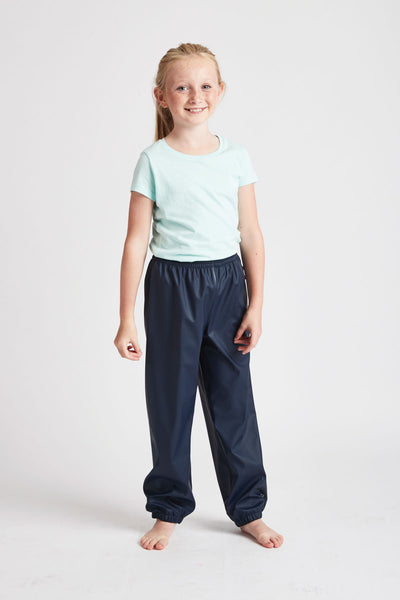Unisex Navy Rain Runners waterproof trousers by British brand Grass & Air - modern, stylish rainwear for kids