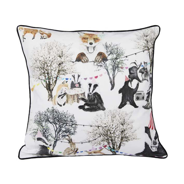Woodland rave print cushion by independent British brand Wild Hearts Wonder featuring variety of woodland animals including foxes, badgers and bunnies on the front and animal spot print on the reverse