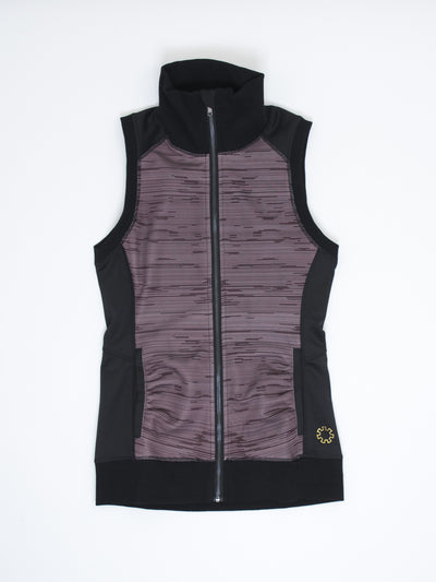 The Stacy is a comfortable, athletic wear vest made from stretchable, moisture wicking fabric.