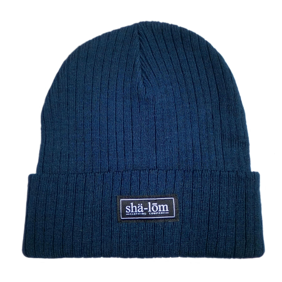 "50/50 Recycled polyester/acrylic Beanie with our Shalom Definition woven label. This beanie is super soft and will keep your head warm. One size fits most.      50/50 Recycled polyester/acrylic     Narrow rib knit     11"" knit with cuff     Woven label     Global Sustainable Recycled Standard"