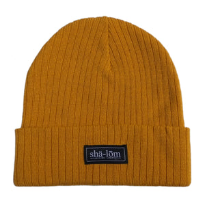 "50/50 Recycled polyester/acrylic Beanie with our Shalom Definition woven label. This beanie is super soft and will keep your head warm. One size fits most. •	50/50 Recycled polyester/acrylic •	Narrow rib knit •	11"" knit with cuff •	Woven label •	Global Sustainable Recycled Standard"
