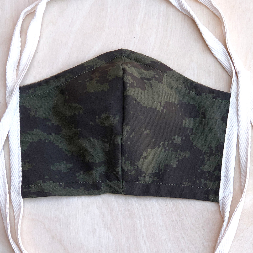 100% Cotton double layer jersey fabric hand cut and sewn with shalom woven labels. This mask is made to cover your face. THIS IS NOT THE N95 MASK. WE SUGGEST LEAVING THOSE MEDICAL MASKS FOR THE PEOPLE IN REAL DANGER AND SERVING TO HELP THOSE WHO ARE SICK. Spaghetti strap ties for a one size fits all feature. Complete with Shalom Digital Camo print in Eco Friendly Waterbase ink with shalom woven loop label on the flip side. Extra diagonal stitch on the corners of the straps for extra strength.