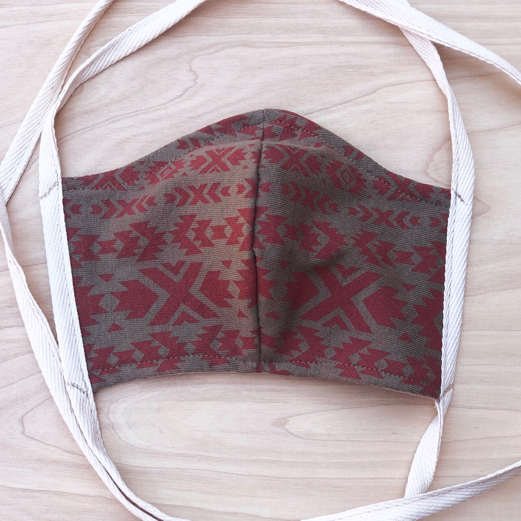 100% Cotton double layer jersey fabric hand cut and sewn with shalom woven labels. This mask is made to cover your face. THIS IS NOT THE N95 MASK. WE SUGGEST LEAVING THOSE MEDICAL MASKS FOR THE PEOPLE IN REAL DANGER AND SERVING TO HELP THOSE WHO ARE SICK. Spaghetti strap ties for a one size fits all feature. Complete with Shalom Native print in Eco Friendly Waterbase ink with shalom woven loop label on the flip side. Extra diagonal stitch on the corners of the straps for extra strength.