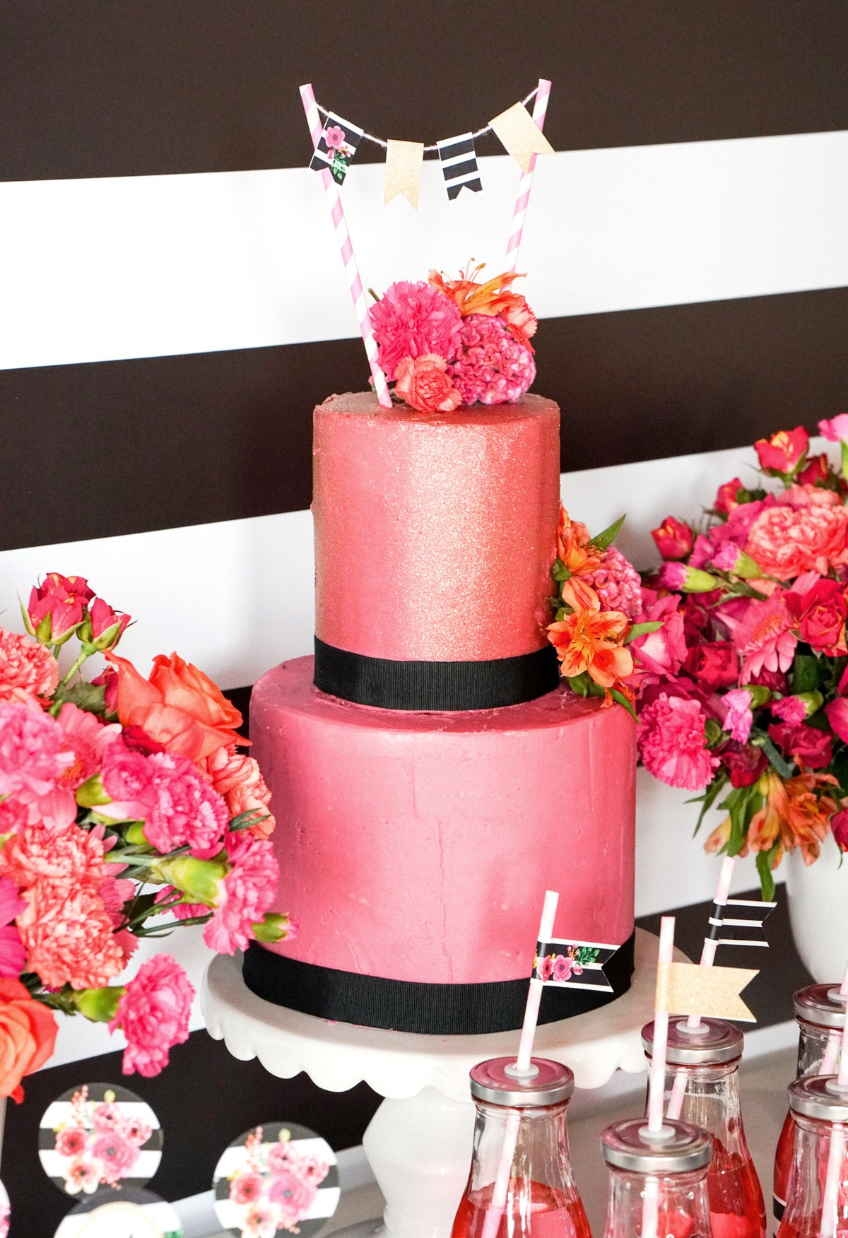 Pink Tiered Cake With Black Ribbon