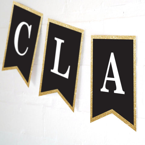 Celebrate graduation banner with a black background, white text (customizable) and gold glitter edging.