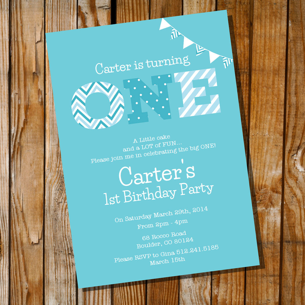 blue first birthday invitation for a boy with the word ONE.