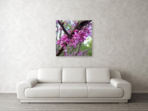 Mockup of canvas print hanging on wall over couch in a room