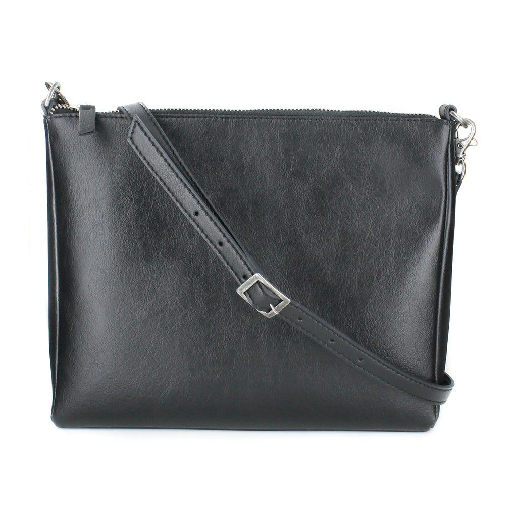 Small rectangular shaped black vegan leather crossbody bag with a long strap. Silver hardware.