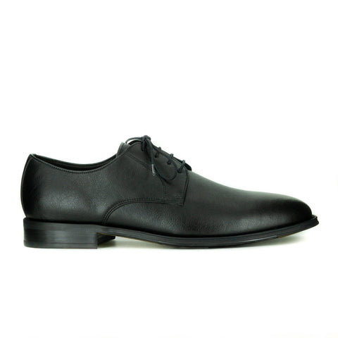 A simple black vegan leather men's dress shoe. Lace up with 4 eyelets, rounded wider toe box. Black sole.