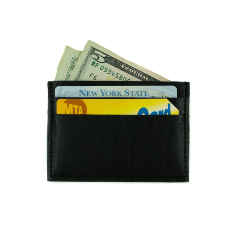 Small cardholder in black vegan leather. 2 card slots on each side and slot in middle. Shown here with cards and cash inside.