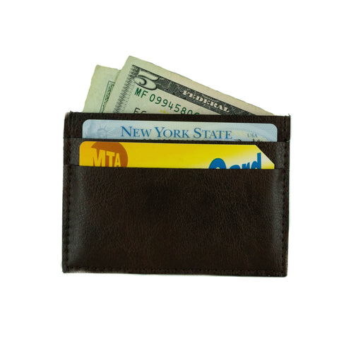 A small cardholder made of dark brown vegan leather. 2 card slots on each side and a center slot, rectangular shaped. Shown here with cards and cash inside.