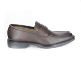 Slip on dress loafer in dark brown vegan leather. Beige lining. Black rubber sole. Slightly squared toe.
