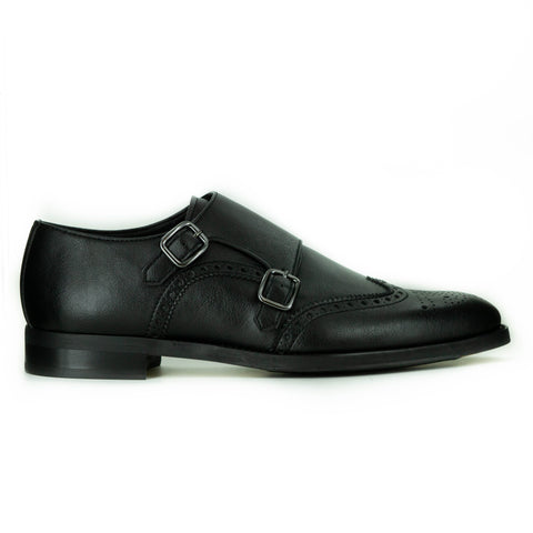 A black dress shoe with double monk detailing - 2 silver buckles on top. Brogue detailing on top. Black sole.