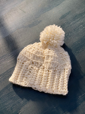 Crochet Pom Pom Beanie in Cream from Julia Galotti