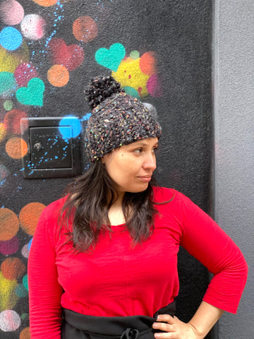 Crochet Pom Pom Beanie in Black from Julia Galotti