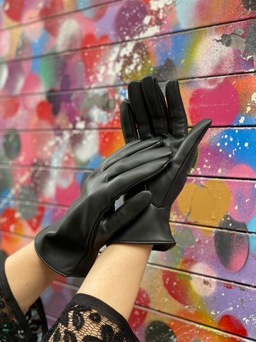 Black vegan leather gloves on a woman's hands