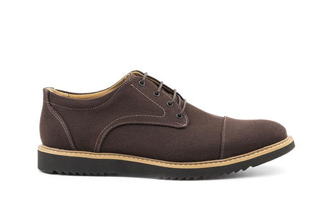 Casual dress shoe in brown canvas. Lace up with 4 eyelets, black laces. Tan outsole and black sole with tread. Beige lining.
