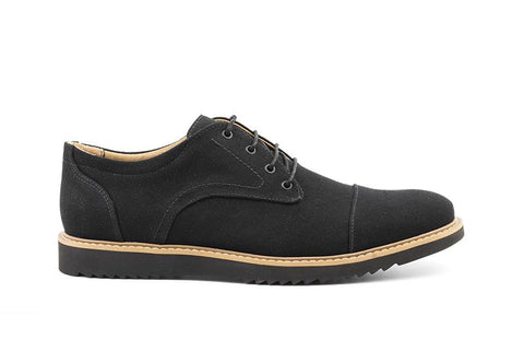 Casual dress shoe in black canvas. Lace up with 4 eyelets, black laces. Tan outsole and black sole with tread. Beige lining.