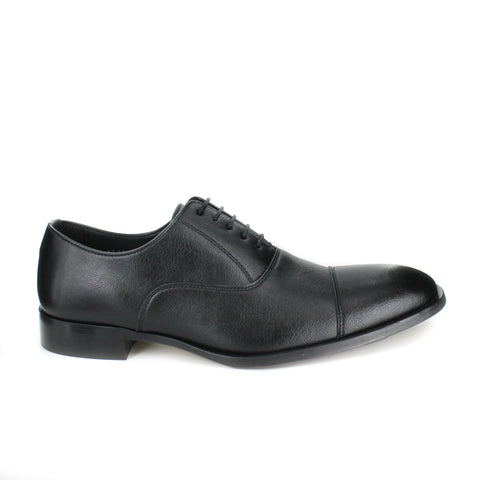 A black vegan leather men's dress shoe with a cap toe. Slightly tapered toe. Lace up with 5 eyelets. Black lining and sole.