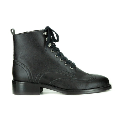 A black vegan leather boot with laces and brogue detailing.  Black sole. On a white background.