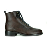 A brown vegan leather boot with laces and brogue detailing.  Black sole. On a white background.