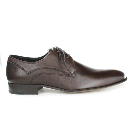 A dark brown vegan leather dress shoe, lace up with 3 eyelets. Slightly tapered, squared toe. Brown heel and tan sole.