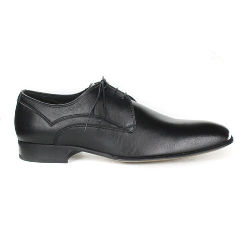 A black vegan leather dress shoe, lace up with 3 eyelets. Slightly tapered, squared toe. Black heel and tan sole.