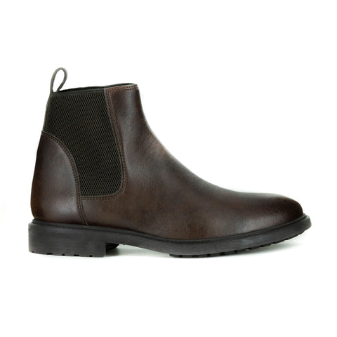 Men's chelsea style boot in dark brown vegan leather. Elastic paneling on sides, pull tab in back, rubber sole with traction.