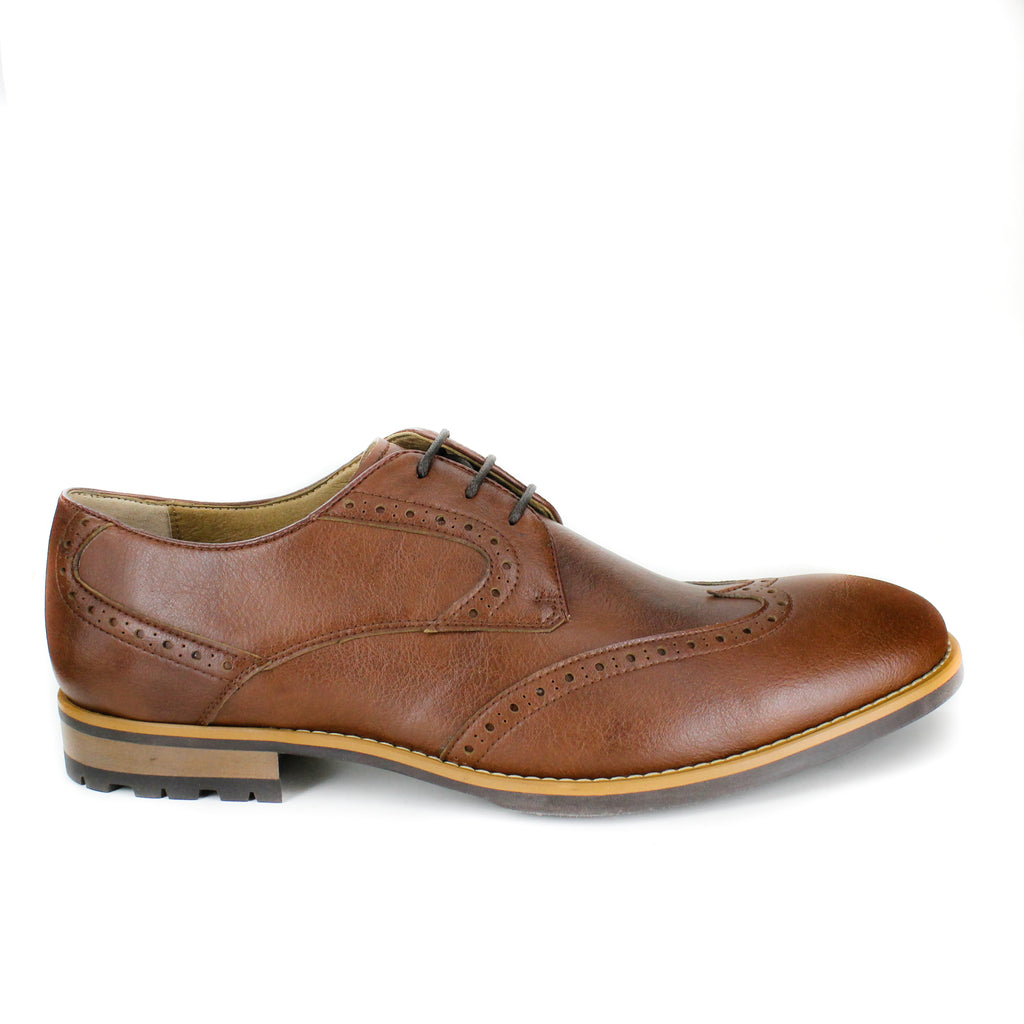 A tan vegan leather brogue dress shoe, lace up with 3 eyelets. Tan and dark brown sole with rubber grip for traction.