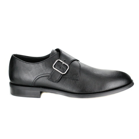 A black vegan leather dress shoe with a silver buckle closure. Black sole. Rounded toe.