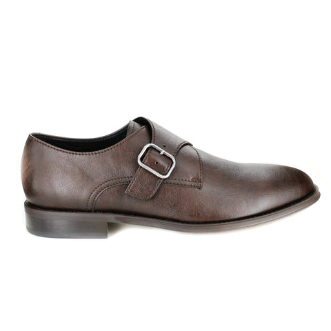 A dark brown vegan leather dress shoe with a silver buckle closure. Dark brown sole. Rounded toe.