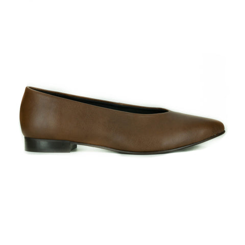 A tan vegan leather slip on flat with a pointed toe and 0.5 inch dark brown heel.