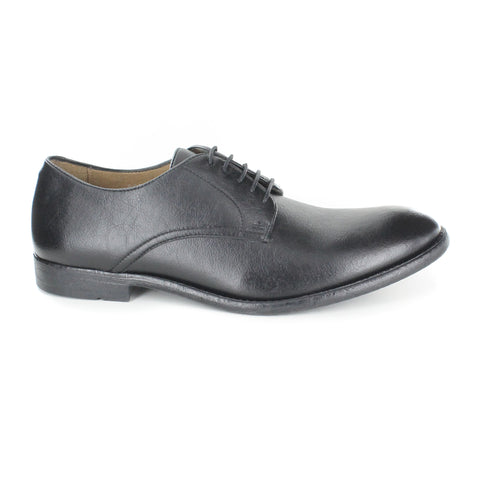 A classic and simple black vegan leather dress shoe. Lace up with 5 eyelets. Black rubber sole. Beige lining. Rounded toe.