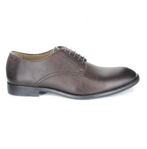 A classic and simple dark brown vegan leather dress shoe. Lace up with 5 eyelets. Black rubber sole. Beige lining. Rounded toe.